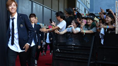 Members of BTS arrive at K-CON at the Los Angeles Memorial Sports Arena on August 10, 2014.