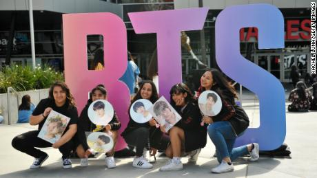 Fans pose outside a BTS concert at the Staples Center in Los Angeles in September 2018.