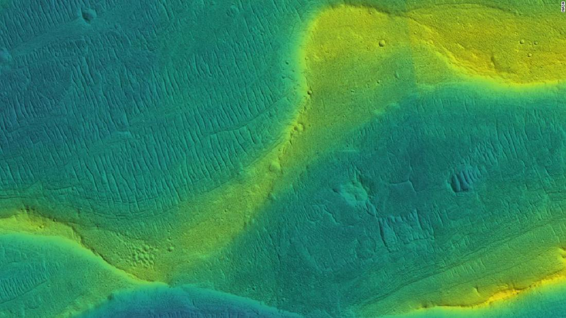 This photo of a preserved river channel on Mars was taken by an orbiting satellite, with color overlaid to show different elevations. Blue is low and yellow is high.