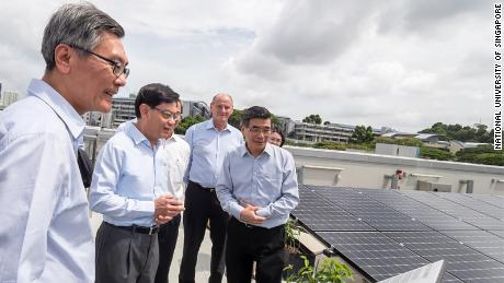 """Visitors view the so-called """"solar farm"""" on the building's roof, which contains over 1,200 panels."""