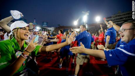 U.S athletes, right, are greeted by volunteers and athletes from the Great Britain at the 2015 Special Olympics World Games in Los Angeles.