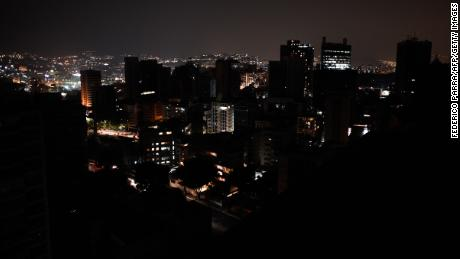 "TOPSHOT - General view of Altamira neighborhood partially illuminated during a power outage in Caracas, Venezuela, on March 26, 2019. - Venezuela decreed a 24-hour holiday Tuesday to cope with a new near-nationwide blackout that the government alleged was caused by an ""attack"" targeting its main hydroelectric plant. (Photo by FEDERICO PARRA / AFP)        (Photo credit should read FEDERICO PARRA/AFP/Getty Images)"