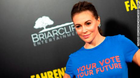 "US actress/activist Alyssa Milano arrives for the premiere of ""Fahrenheit 11/9"" at the Samuel Goldwyn theatre in Beverly Hills, California on September 19, 2018. (Photo by VALERIE MACON / AFP)        (Photo credit should read VALERIE MACON/AFP/Getty Images)"