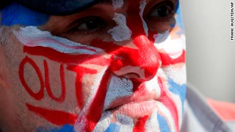 "A Brexit supporter wears the Union Jack colors on his face at Parliament Square in Westminster, London, Friday, March 29, 2019. Pro-Brexit demonstrators were gathering in central London on the day that Britain was originally scheduled to leave the European Union. British lawmakers will vote Friday on what Prime Minister Theresa May's government described as the ""last chance to vote for Brexit."" (AP Photo/ Frank Augstein)"