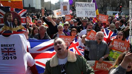 Pro-Brexit demonstrators carry placards and Union flags as they gather in Parliament Square in central London on March 29, 2019. - MPs are set for a momentous third vote today on Prime Minister Theresa May's Brexit deal, which could end a months-long political crisis or risk Britain crashing out of the EU in two weeks. (Photo by Daniel LEAL-OLIVAS / AFP)        (Photo credit should read DANIEL LEAL-OLIVAS/AFP/Getty Images)
