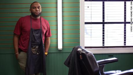 Jermaine Lewis co-owns the Kuttin' Edges barber shop in Norfolk, VIrginia.