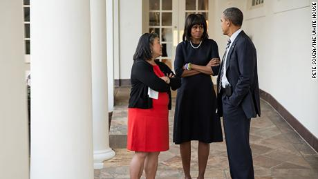 Tina Tchen talks with the Obamas in 2013 at the White House.