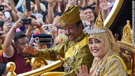 Sultan Hassanal Bolkiah and Queen Saleha ride in 2017 procession to mark its golden jubilee.
