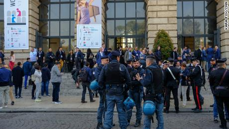 Riot police stand alert outside the World Congress of Families venue in the ancient city's Piazza Bra as a neo-fascist leader delivered a press conference outside.