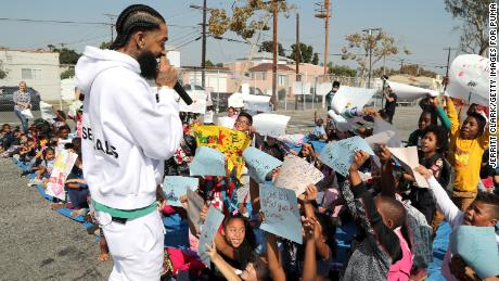 Nipsey Hussle speaks to kids at the Nipsey Hussle x PUMA Hoops Basketball Court Refurbishment Reveal Event on October 22, 2018 in Los Angeles, California.