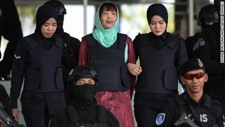 Vietnamese national Doan Thi Huong (C) is escorted by Malaysian police out of the High Court in Shah Alam on April 1, 2019. - A Vietnamese woman accused of assassinating the North Korean leader's half-brother will walk free in May after pleading guilty to a lesser charge, her lawyer said. (Photo by Mohd RASFAN / AFP)        (Photo credit should read MOHD RASFAN/AFP/Getty Images)