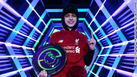 Liverpool's Donovan Hunt 'F2Tekkz' celebrates becoming the first ePremier League champion.