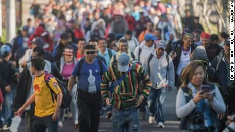 """Salvadoran migrants begin their journey in caravan heading the United States, in San Salvador, on November 18, 2018. - The migrants are mostly fleeing poverty and unrest in Central America's """"Northern Triangle"""" -- El Salvador, Guatemala and Honduras, where brutal gang violence has fuelled some of the highest murder rates in the world. (Photo by MARVIN RECINOS / AFP)        (Photo credit should read MARVIN RECINOS/AFP/Getty Images)"""