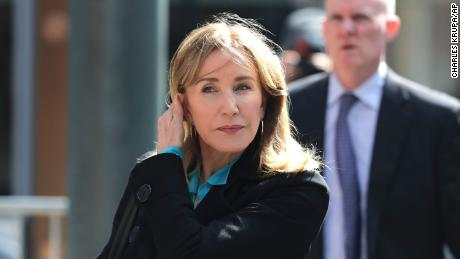 Actress Felicity Huffman arrives at federal court in Boston on Wednesday.