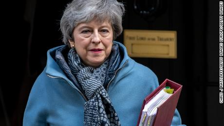 British Prime Minister Theresa May leaves Downing Street for Prime Minister's Questions.