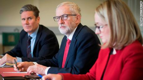 Labour leader Jeremy Corbyn (center) and key aides gather before a meeting with Theresa May
