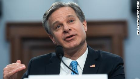 FBI Director Wray distances himself from Barr's use of 'spying' on Trump campaign