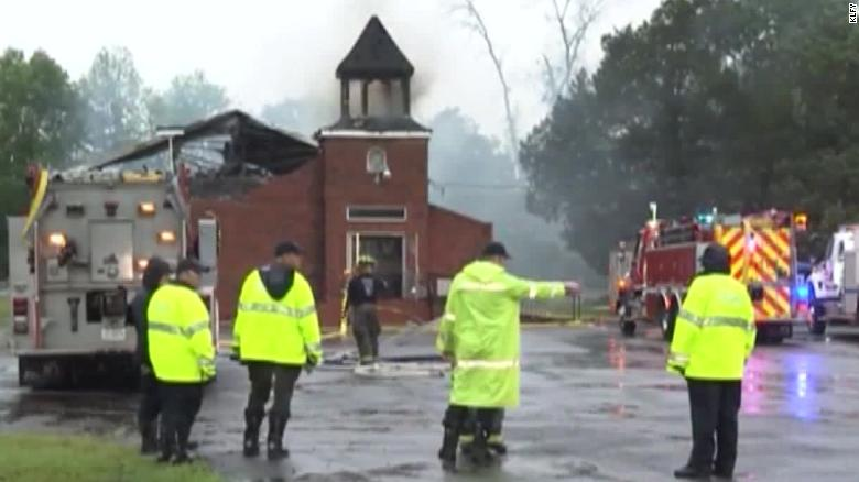 Shock at arrest of deputy's son in black church fires