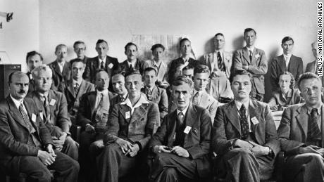 Eric Burhop (seated, fourth from left, partially obscured) and the rest of the British Group associated with the Manhattan Project, also known as the Mark Oliphant Group
