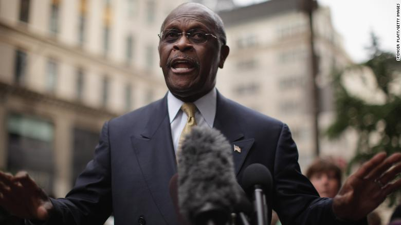 Trump stands by controversial Fed pick Herman Cain