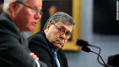 Attorney General William Barr looks over toward Assistant Attorney General for Administration, Lee J. Lofthus, left, as they appear before a House Appropriations subcommittee, on Capitol Hill, Tuesday, April 9, 2019, in Washington. Barr is defending his decision to send a letter to Congress detailing special counsel Robert Mueller's principal conclusions. He says the public would not have tolerated waiting weeks for information.(AP Photo/Andrew Harnik)