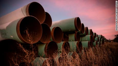 Miles of pipe for the proposed Keystone XL pipeline sit in a lot in October 2014.