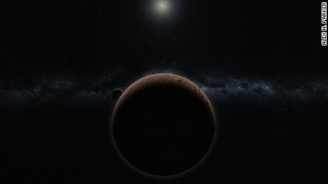 Artist's concept of 2007 OR10 -- the largest unnamed solar system object yet discovered -- and its moon.