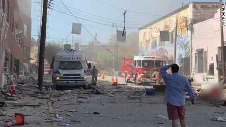 The aftermath of an explosion in downtown Durham, NC. CNN has blurred a figure at bottom-right due to a graphic injury.