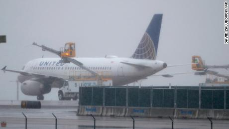 A United Airlines plane is deiced before taking off from Denver International Airport on Wednesday.