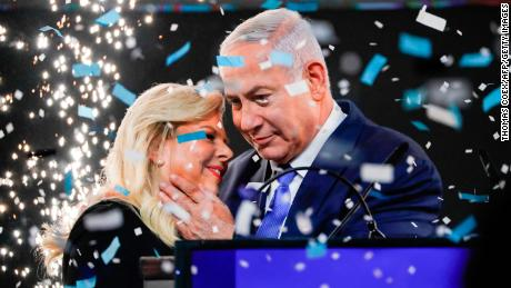 Israeli PM Benjamin Netanyahu embraces his wife Sara at Likud Party headquarters in Tel Aviv on election night on April 10, 2019.