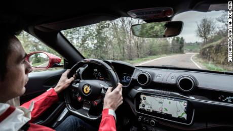 Maranello, Italy. A day with Ferrari test driver Raffaele de Simone. Raffaele de Simone test driving a Ferrari Portofino on the hills around Maranello.