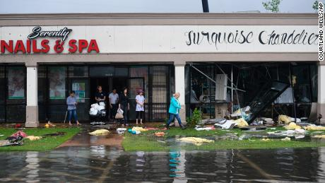 Debris at a strip mall Saturday  following the severe weather in Vicksburg, Mississsippi.