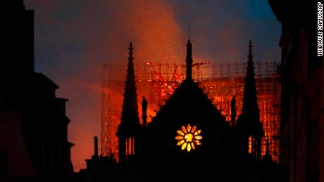 Flames and smoke rise from Notre Dame Cathedral as it burns in Paris.