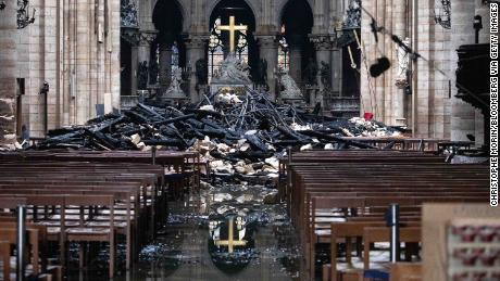 Fallen debris from the burned roof structure sits near the altar inside Notre Dame Cathedral.