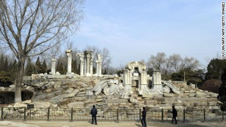 Tourist look at the ruins of the Guanshuifa Fountain which was built in 1759 during the period of Qing Emperor Qianlong, at the Old Summer Palace, also called Yuanmingyuan, in Beijing on February 24, 2009.