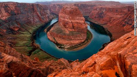 The Colorado River wraps around Horseshoe Bend near Page, Arizona. A study last year found that the river's flows have decreased by about 20% over the last century, due in large part to climate change.