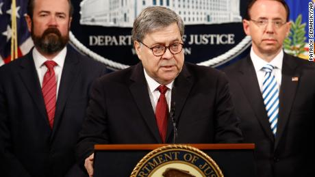 Attorney General William Barr speaks alongside Deputy Attorney General Rod Rosenstein, right and Deputy Attorney General Ed O'Callaghan, left, about the release of a redacted version of special counsel Robert Mueller's report during a news conference, Thursday, April 18, 2019, at the Department of Justice in Washington. (AP Photo/Patrick Semansky)