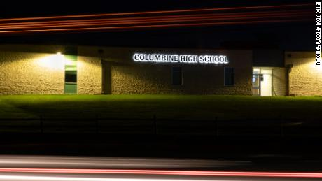 Lights streak as a truck drives by Columbine High School in Littleton, Colorado, in this long-exposure photograph.