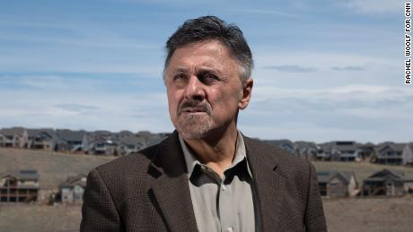 Frank DeAngelis stands outside his home.