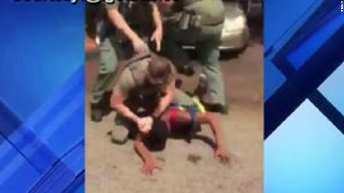 A Florida deputy is under investigation after viral video appears to show him slamming teen's head into the ground - CNN