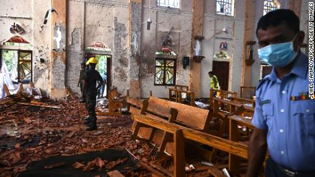 Security personnel inspect the interior of St Sebastian's Church in Negombo on April 22, 2019, a day after the church was hit in series of bomb blasts.