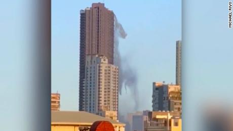 Earthquake sends water tumbling from high-rise roof
