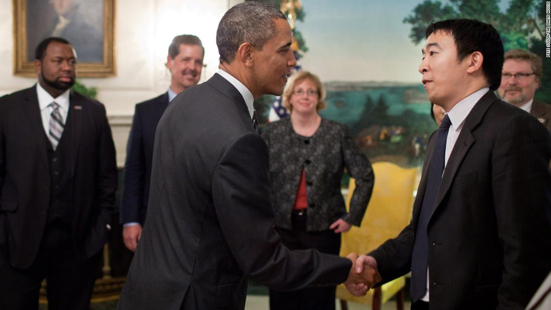 "Yang is greeted by President Barack Obama in a White House reception room in 2012. Yang was among those honored as a ""Champion of Change."" He started Venture for America, a fellowship program that aims to connect recent college graduates with startups."