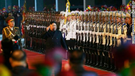 In this photo provided by the North Korean government, North Korean leader Kim Jong Un inspects an honor guard at an undisclosed train station in North Korea on Wednesday before leaving for Russia.