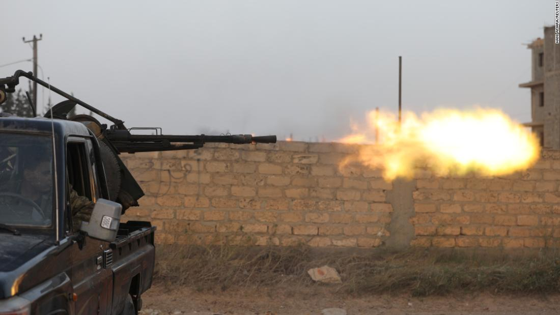 Members of Libya's internationally recognized government forces fire during fighting with Haftar's forces in Ain Zara on April 20.