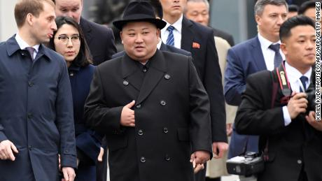 Kim was greeted by officials upon arrival.