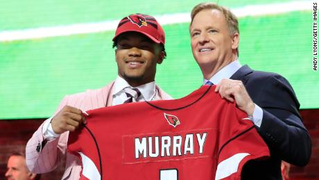 Murray poses with NFL Commissioner Roger Goodell after he was picked by the Cardinals.