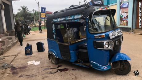 The rickshaw where a woman died in a Sri Lanka raid Friday night.