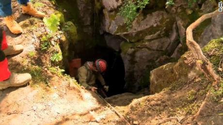 Rescuers enter a cave in southwest Virginia where five men are trapped on April 28, 2019.