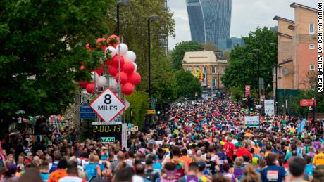 Runners at the 8 mile marker with a view of the Walkie Talkie building in the background. The Virgin Money London Marathon, 28 April 2019.  Photo: Jed Leicester for Virgin Money London Marathon  For further information: media@londonmarathonevents.co.uk